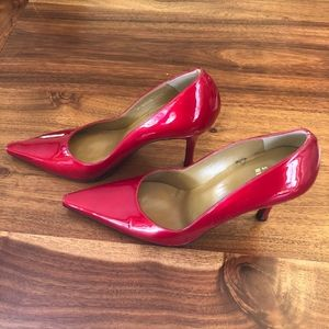 Red Shiny Stuart Weitzman pump heels triangle toe